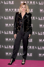 Ashley Roberts looked fabulous in a black leather jacket layered over a jumpsuit while attending Maybelline's Bring on the Night party.