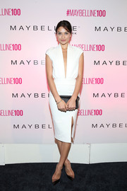 Shanina Shaik opted for a simple yet sexy deep-V LWD for Maybelline's 100th anniversary party.