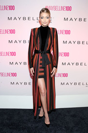 Gigi Hadid attended Maybelline's 100th anniversary party wearing a bold-shouldered, striped Balmain coat.