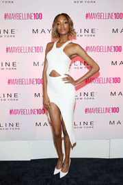 Jourdan Dunn flashed some abs and a whole lotta leg in a white Self-Portrait cutout dress during Maybelline's 100th anniversary party.