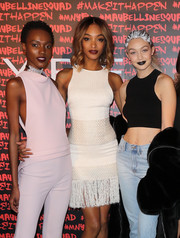 Jourdan Dunn attended the Maybelline celebration of Fashion Week wearing a sleeveless white mini dress with a fringed hem.