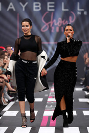 Nicole Scherzinger performed at the Maybelline New York show wearing a sparkly black crop-top by Balmain.