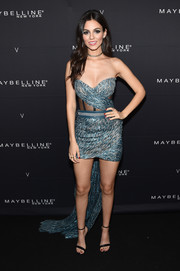 Victoria Justice vamped it up in a strapless blue mini dress with a sheer midsection and a floor-sweeping train at the Maybelline x V Magazine party.