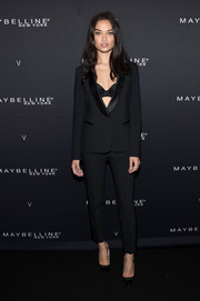 Shanina Shaik polished off her look with a pair of grommeted pumps.