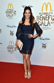 Johanna Klum looked ladylike in a navy off-the-shoulder lace dress at the McDonald's Charity Gala.