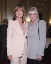 Linda Evans looked subdued yet classic in a gray double-breasted tweed blazer.