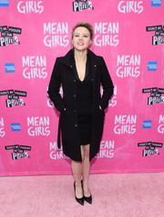 Kate McKinnon arrived for the Broadway opening of 'Mean Girls' looking stylish in a black coat layered over a matching dress.