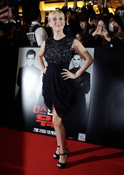 Reese showed off her fit figure in a black draped dress paired with subtle strappy sandals.
