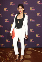 A crisp white pantsuit with black trim gave Freida Pinto a totally chic look at 'Chime for Change: The Sound of Change Live.'