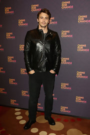 James wore a pair of black classic jeans with his sleek leather jacket.