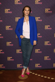 Yasmin Le Bon wore a bright blue blazer with a flowing halter top and jeans.
