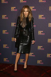 J. Lo rocked a totally edgy and sexy look witht his snakeskin skirt suit that featured a lace-paneled peplum jacket.