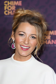This pop of pink lipstick enhanced Blake's fuchsia earrings.