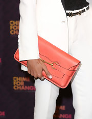 Freida Pinto's coral clutch brightened up her crisp white suit.