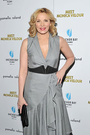 Kim Cattrall matched her black satin clutch to her waist cinching belt.