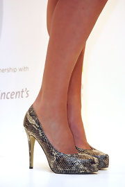 Megan Gale wore a super-stylish pair of gray snakeskin pumps to the New Women's Health Initiative event.