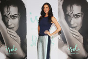 Megan Gale was sporty-chic in a navy tank top paired with print pants during an Isola Swimwear event.