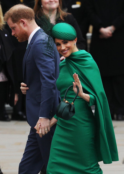 Meghan Markle Decorative Hat [green,fashion,human,outerwear,event,dress,headgear,gesture,fashion accessory,style,outerwear,harry,socialite,human,service,fashion,sussex,commonwealth service,duke of sussex,event,fashion,socialite]