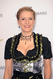 Stefanie Hertel wore her hair in two classic French braids at the Mein Star de Jahres Awards in Hamburg, Germany.