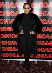 Melanie Brown glammed up her look with a black fur coat.