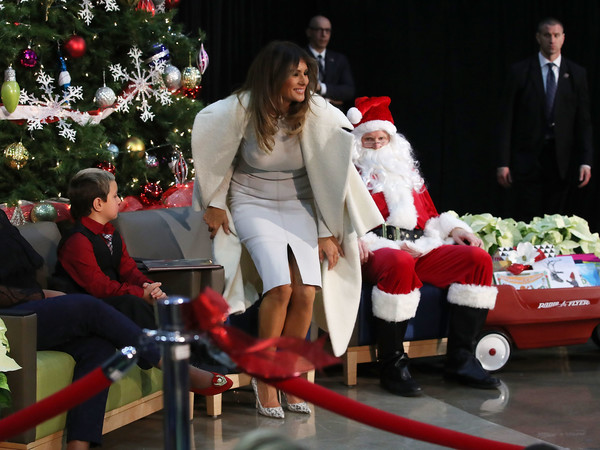 Melania Trump Wool Coat [melania trump reads to patients at dc childrens hospital a christmas story,book,the polar express,santa claus,red,christmas,christmas eve,event,fictional character,lap,christmas decoration,fun,holiday,melania trump,children,person,damian contreras,washington dc,visit,christmas]