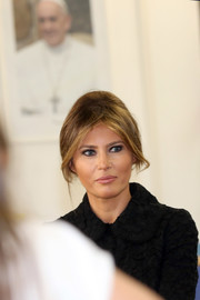 Melania Trump swept her hair up into a loose bun for her visit to the Pediatric Hospital Bambin Gesu in Vatican City.