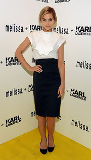 Leigh Lezark chose a classic black pencil skirt for her black-and-white look at the Melissa + Karl Lagerfeld launch in NYC.
