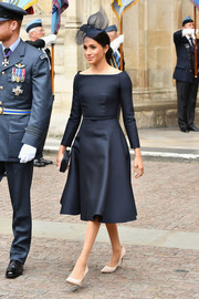 Meghan Markle was the picture of elegance in a boatneck LBD by Dior at the RAF centenary event.