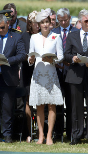 Kate Middleton looked downright regal in an embroidered pale-gray coat dress by Catherine Walker at the Passchendaele commemorations in Belgium.