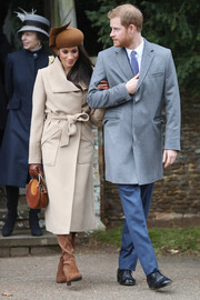 Meghan Markle looked refined in a belted beige coat by Sentaler when she joined the royal family for Christmas Day church service.