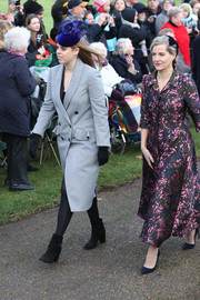 Princess Beatrice headed to Christmas Day church service wearing a double-breasted gray coat with ruffled pocket flaps.