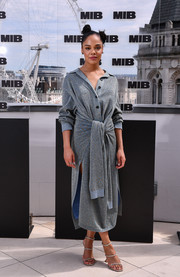 Tessa Thompson styled her dress with silver triple-strap sandals by Amina Muaddi.