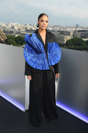 Tessa Thompson showed off her unique style with this structured jacket and wide-leg pants combo by Robert Wun at the 'Men in Black: International' photocall in Paris.