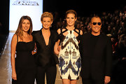 Michael Kors even walks the runway with his signature aviator shades on.