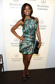 Gabrielle Union complemented her satin mini dress with a black leather clutch.