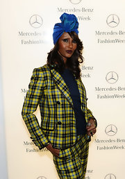 Iman donned an iridescent turban with her plaid suit for Fashion Week.