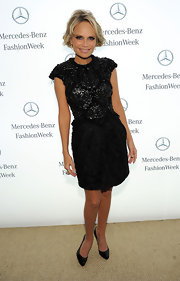 Kristin Chenoweth wore a black iridescent cocktail dress to NYFW.