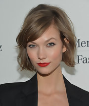 Karlie Kloss looked flawlessly made up with her bright red lips and cat eyes during Mercedes-Benz Fashion Week.