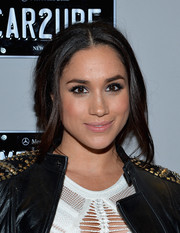 Meghan Markle visited the Mercedes-Benz Star Lounge during Fashion Week wearing this very loose updo.