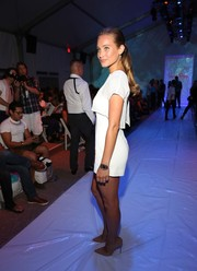 SI Swimsuit model Hannah Davis wore her hair in a classic pony for Fashion Week Swim in Miami.