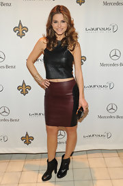 Maria paired her pencil skirt with black leather booties.