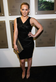 Actress Hilary Duff flaunted her printed clutch and body hugging black dress while attending Mercedes Benz Fashion Week.