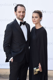 Keri Russell attended the Met Opera opening performance of 'Tristan und Isolde' carrying a sophisticated mother-of-pearl clutch.