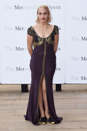Jemima Kirke oozed vintage glamour in a purple gown with gold trim at the Met Opera opening performance of 'Tristan und Isolde.'