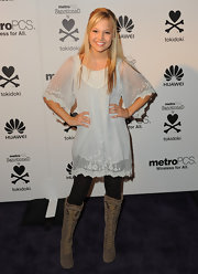 These knee-high lace-up boots edged up Olivia Holt's otherwise boho ensemble.