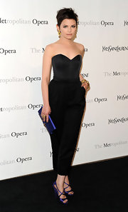 Ginnifer offset her black strapless jumper with a pair of vibrant purple strappy sandals.