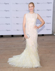 Kelly Rutherford was dressed to impress in a sleeveless white evening dress with a feathered skirt at the 'Eugene Onegin' opening.