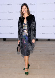 Jill Hennessy layered a black velvet coat over a print dress for an elegant finish at the 'Eugene Onegin' opening.