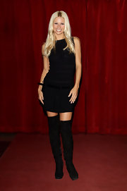 Michelle added a sexy '60s vibe to her look with these over-the-knee black boots and a black shift dress.