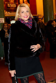 Simona Ventura kept warm in luxurious style with a black fur jacket.